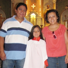 Parents Marco and Veronica with our newest altar server, Karen