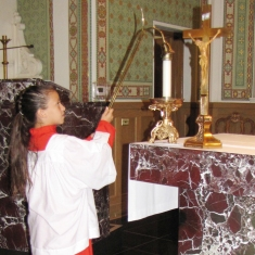 Lauren extinguishes a candle after Mass