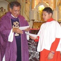 Monsignor Jorge De los Santos congratulates Derrick