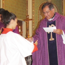 Esmeralda is congratulated by Monsignor Jorge De los Santos