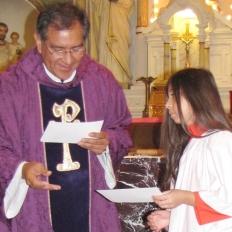 Monsignor congratulates Karen for her service