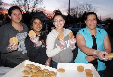 Alma Bustilos and her daughters give the gift of home made bread