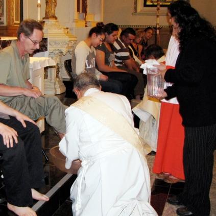 Deacon Harold washes feet on Holy Thursday