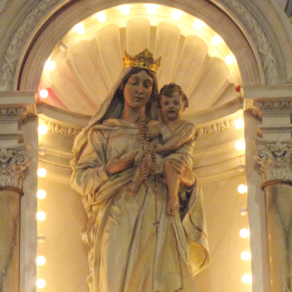 The name of the parish is  Queen of the Holy Rosary