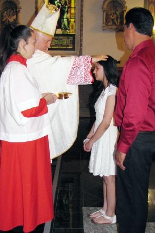 The Archbishops confers the sacrament